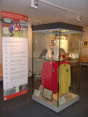 International shirts in the exhibition, From Robins to Dragons, which marked the culmination of the battle for control of the club from Alex Hamilton and Mark Guterman / Crysau rhyngwladol yn yr arddangosfa, O'r Robiniaid i'r Dreigiau, a farciodd diwedd y brwydr am reolaeth y clwb oddi wrth Alex Hamilton a Mark Guterman